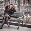 Stock Photo: Sad girl sits on bench