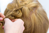 Hairdresser make braids — Stock Photo