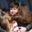 Young man embracing two girls on the street. — Stock Photo #44573421