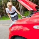 Blonde and broken car — Stock Photo #6681871