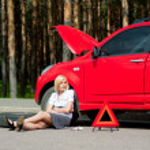 Blonde and broken car — Stock Photo #6682055