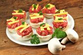 Preparation - stuffed mushrooms — Stock Photo