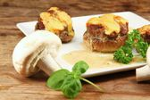 Preparation - stuffed mushrooms — Stock Photo