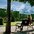 Back of young woman relaxing in park — Stock Photo #4942278