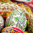 Easter painted eggs in traditional basket — Stock Photo #9932679