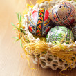 Easter painted eggs in traditional basket — Stock Photo #9932709