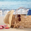 Stock Photo: Summer beach bag on sandy beach