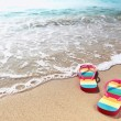 Stock Photo: Flipflops on sandy ocebeach