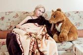 Woman with teddy bear — Stock Photo