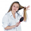 Young woman with comb — Stock Photo #2518881