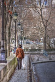 The man walks with a dog. Paris. France — Stock Photo