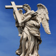 Angel with a cross — Stock Photo