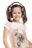 Kid listening to popular music — Стоковое фото