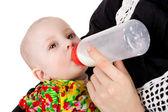 Baby and milk — Stock Photo