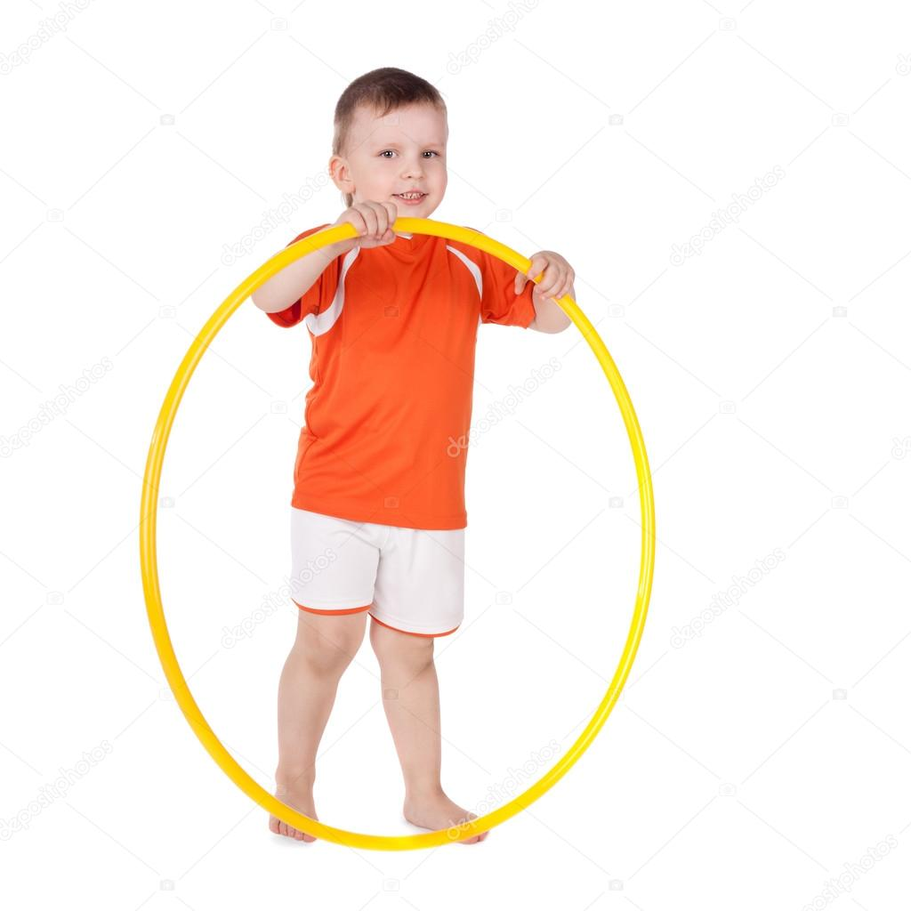 Cute smiling little boy with a hoop  Stock Photo #13614529