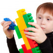 Boy playing with the bricks - Stock Photo