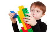 Boy playing with the bricks — Stock Photo