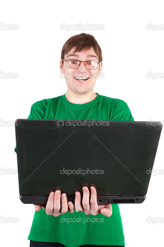 Cute young man looking at something funny in the notebook  Stock Photo #13818332