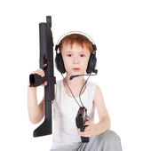 Boy and weapon — Stock Photo