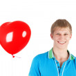 Stock Photo: Young boy with heart shape balloon