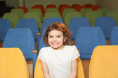 Girl in the cinema hall — Stock Photo