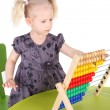 Girl with the abacus — Stock Photo