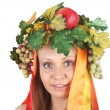 Girl in the season fruit garland — Stock Photo
