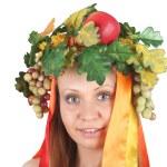 Girl in the season fruit garland — Stock Photo