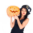 Witch with the Halloween pumpkin — Stock Photo