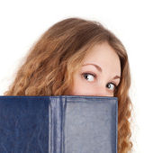 Girl looking out of the note book — Stock Photo