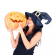 Stock Photo: Witch with the Halloween pumpkin