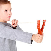 Boy shooting from a slingshot — Foto Stock