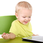 Baby with the tablet PC — Stockfoto