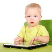 Baby with the tablet PC — 图库照片