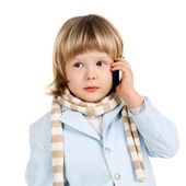 Child speaking a mobile phone — Stock Photo