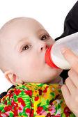 Baby sucking milk — Stock Photo