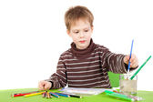 Little boy painting — Stock fotografie