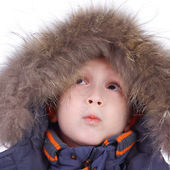 Child in the winter fur clothing — Stock Photo