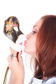 Girl kissing the theatrical mask — Stockfoto
