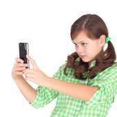 Girl shooting by her mobile phone — Stock Photo