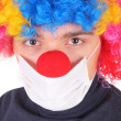 Clown in the medical mask — Stock Photo #40394797
