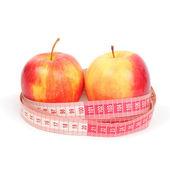 Tape line around apples — Stock Photo