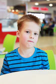 Little boy in the cafe — Stock Photo