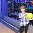 Girl playing bowling — Stock Photo