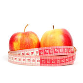 Apples and tape line — Stock Photo