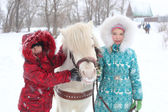 Childrens and horse — Stock Photo