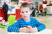 Boy with the apple — Stock Photo