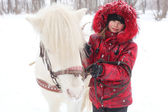 Child and horse — Stock Photo