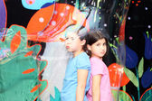 Sisters inside the soap bubble — Stock Photo
