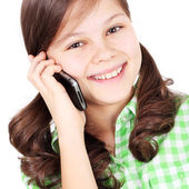 Girl speaking by mobile phone — Stock Photo